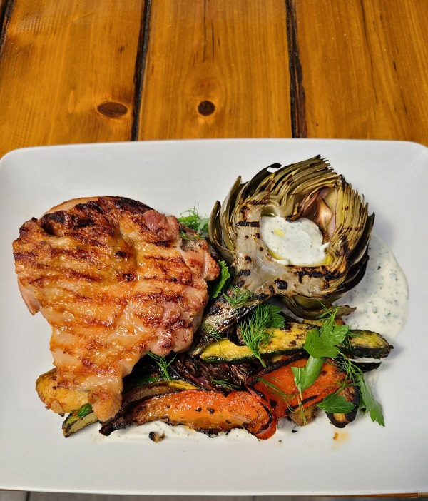 Jack Rose Dining Saloon featurs grilled favorites this summer. The Adams Morgan restaurant-saloon features perfect-for-the-season grilled favorites, including Summer Vegetable and Spicy Shrimp Quesadillas, Grilled Romaine Salad with corn, avocado, cherry tomato, cilantro lime vinaigrette; new Grilled Breads topped with everything from Carolina gold BBQ-marinated pulled pork, to fresh mozzarella/heirloom tomato caprese salad; and hearty grilled half chickens, steaks and seafood.Photo by Jack Rose.