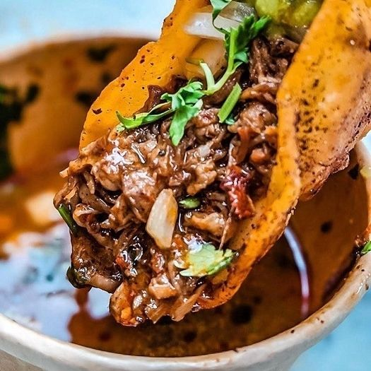 The Alexandria Taco Rock offers a plentiful selection of tasty tacos, including the Birria Taco, at Pinecrest Plaza